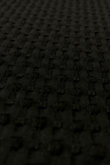 Poly and cotton Swiss Dot Brocade with Black Dots0