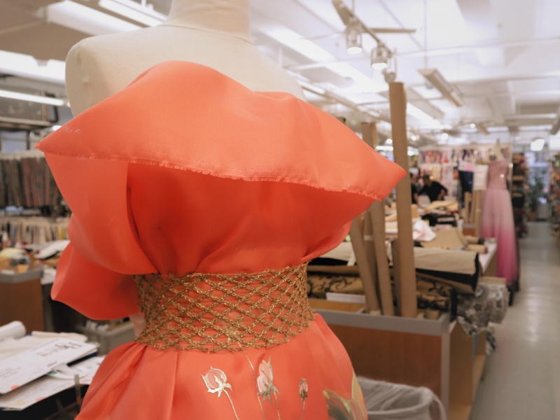 Sample Mannequin in the B&J Fabrics Showroom with Peach Silk Gazar and Metallic Netting