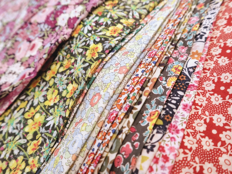 A Selection of Liberty London Floral Prints ranging from reds, to greens, to multi-colored cotton
